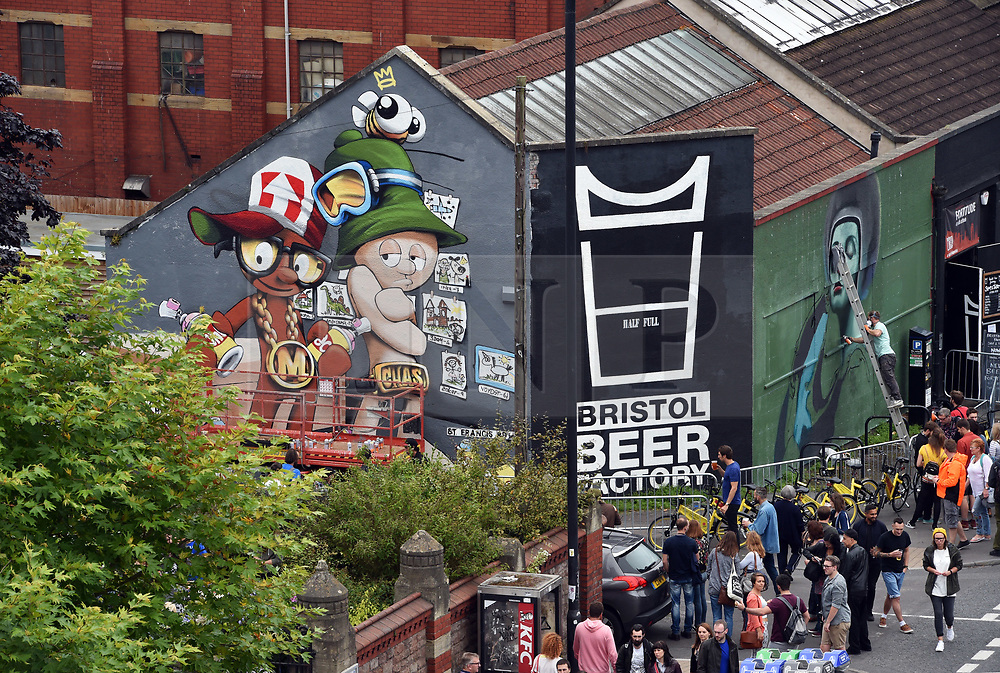© Licensed to London News Pictures.  29/07/2017; Bristol, UK. Upfest 2017. A mural in progress featuring the Aardman character Morph painted by artist Cheo on the Bristol Beer Factory to celebrate Morph's 40th birthday at Upfest, Europe's largest street art festival held annually in Bedminster, Bristol. The festival officially runs from 29 - 31 July with over 350 artists live painting in 37 locations including this Ashton Gate stadium, home of Bristol City FC. Picture credit : Simon Chapman/LNP