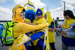 Oxford United fans embrace a Coventry City fan in fancy dress - Photo mandatory by-line: Jason Brown/JMP -  02/04//2017 - SPORT - Football - London - Wembley Stadium - Coventry City v Oxford United - Checkatrade Trophy Final
