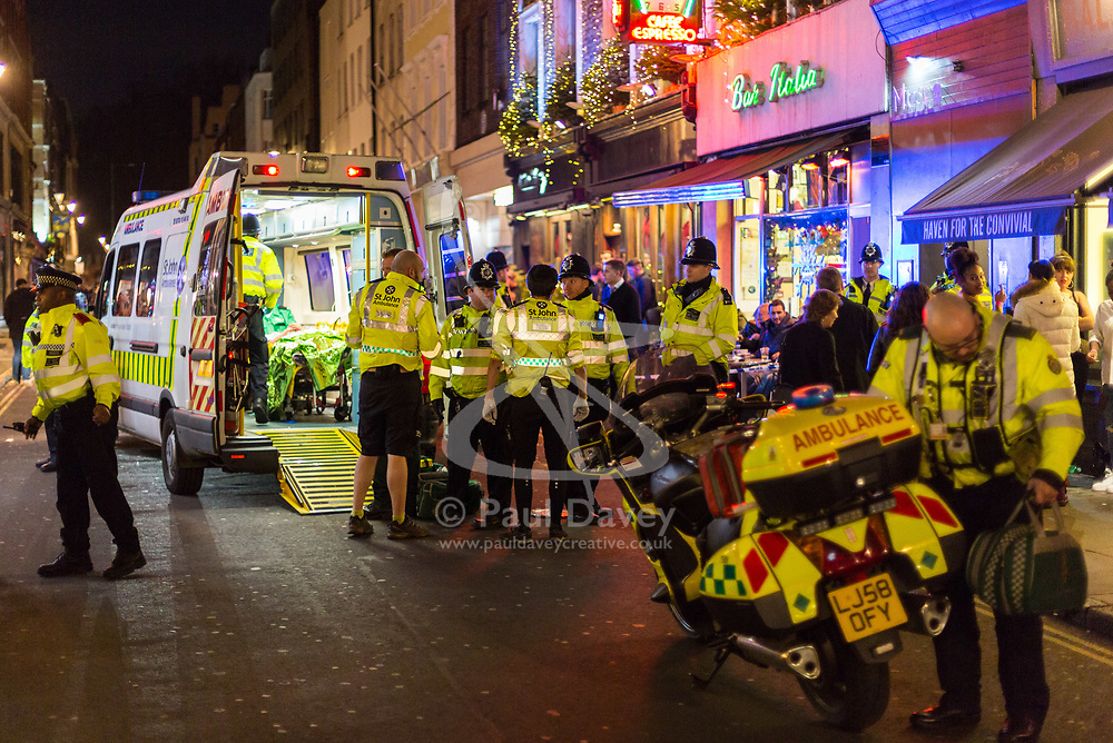 London, January 01 2018. Police and paramedics attend to a serious assault at Muse Soho on Frith Street as revellers in London's West End enjoy New Year's Eve. © SWNS
