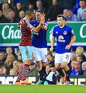 West Ham's Winston Reid berates James McCarthy of Everton following a challenge - Everton vs. West Ham United - Barclay's Premier League - Goodison Park - Liverpool - 22/11/2014 Pic Philip Oldham/Sportimage