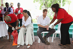 Rihanna (centre left) and Prince Harry take part in a live HIV test, at the 'Man Aware' event held by the Barbados National HIV/AIDS Commission in Bridgetown, Barbados, during his tour of the Caribbean.