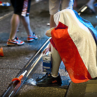 The Netherlands, Amsterdam, 11-07-2010.<br /> A supporter of the Dutch national football team is sitting on the sidewalk in Amsterdam and mourning about the loss of the Dutch in the final of the World Cup in South-Africa against Spain. <br /> Photo : Klaas Jan van der Weij