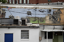 11 July 2015:   A mural depicts a combat scene on the back of the building that houses the American Legion Carl S Martin post 635.  Shot while attending the 2015 Sugar Creek Arts Festival in Uptown Normal Illinois