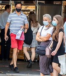 © Licensed to London News Pictures. 23/07/2020. London, UK. Shoppers and workers get their takeaway from Pret A Manger in Chelsea while wearing masks before it becomes compulsory in shops in England tomorrow. Face masks will be compulsory in shops, takeaway cafes and supermarkets from 24th July and enforced by the Police, with anyone who fails to wear one liable to a £100 fine. Photo credit: Alex Lentati/LNP