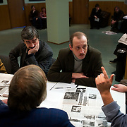 Editors (foreground) and reporters (background) attend a morning meeting at the editorial office of the Novaya Gazeta newspaper in Moscow. .Novaya Gazeta, known for its critical stance, counted among its journalists Anna Politkovskaya, shot dead in her apartment block in October 2006..Politkovskaya was one of the strongest voices against the Kremlin and its policy in Chechnya. Two other journalist at Novaya Gazeta were murdered before her.