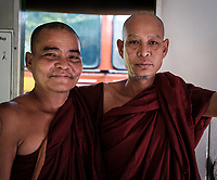 YANGON, MYANMAR - CIRCA DECEMBER 2017: Portrait of monks at the Circular Train Railway in Yangon