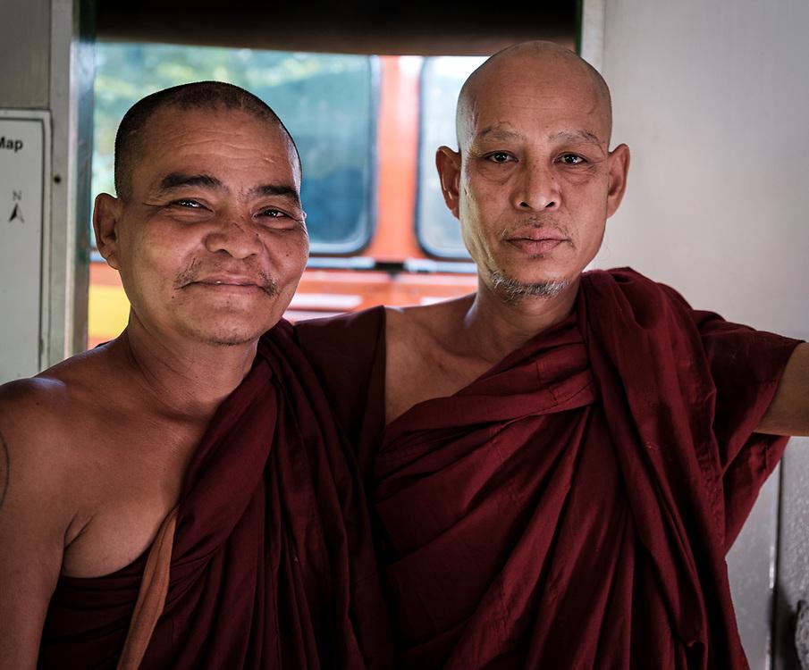 YANGON, MYANMAR - CIRCA DECEMBER 2017: Portrait of monks at the Circular Train Railway in Yangon
