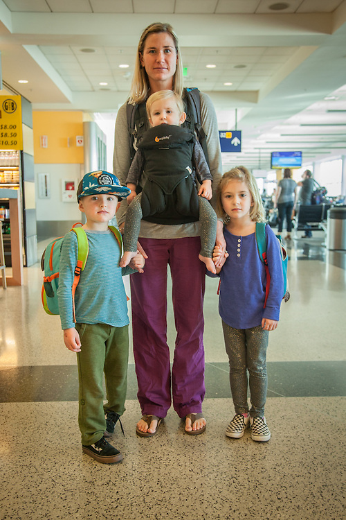 """Tory Spengler with her kids at the Oakland International Airport head home for Thanksgiving  """"Dad left a day early."""""""