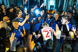 © Licensed to London News Pictures. 09/05/2021. Bolton, UK. RICARDO SANTOS and HARRY BROCKBANK amongst team members celebrating . Bolton Wonderers supporters celebrate outside the team hotel at the University of Bolton stadium after BWFC won promotion to League One following the team's 1-4 victory over Crawley Town . Photo credit: Joel Goodman/LNP