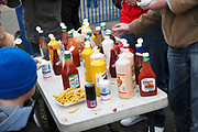Fast food tomato ketchup mustard sauce plastic bottles containers Ipswich Town football,  England UK