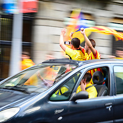Catalans drive around Barcelona waving flags during the National Day of Catalonia.
