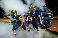 The Oak Ridge Trojans take the field before the game as the Oak Ridge Trojans host the Folsom Bulldogs, Friday October 30, 2015.<br /> Brian Baer/Special to the Bee