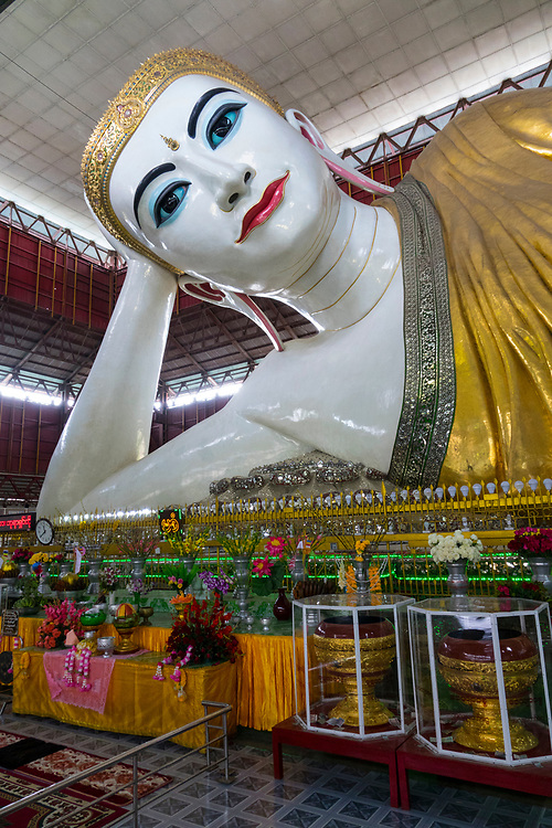 The impressive giant reclining buddha at Chauk Htat Gyi Paya in Yangon is more than 65m long and 16m high. The footprint sculptural relief tells the story of the lives of Buddha.
