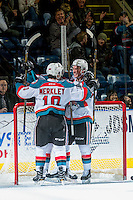 KELOWNA, CANADA - DECEMBER 27: Nick Merkley #10, Rodney Southam #17 and Conner Bruggen-Cate #20 of the Kelowna Rockets celebrate a goal against the Kamloops Blazers on December 27, 2016 at Prospera Place in Kelowna, British Columbia, Canada.  (Photo by Marissa Baecker/Shoot the Breeze)  *** Local Caption ***