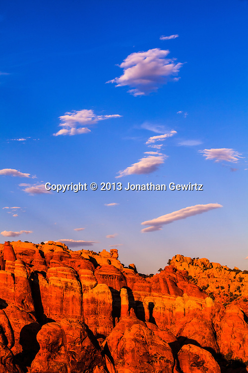 The Fiery Furnace geological formation in Arches National Park, Utah in warm, late-afternoon sunlight. WATERMARKS WILL NOT APPEAR ON PRINTS OR LICENSED IMAGES.<br /> <br /> Licensing: https://tandemstock.com/assets/42268177