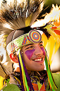 A Native Americans dancer from the Arapahoe people dressed in traditional costume at the Indian Village during Cheyenne Frontier Days July 25, 2015 in Cheyenne, Wyoming. Frontier Days celebrates the cowboy traditions of the west with a rodeo, parade and fair.