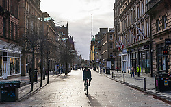 Glasgow, Scotland, UK. 21 November 2020. Views of Saturday afternoon in Glasgow city centre on first day of level 4 lockdown. Non essential shops and businesses have closed. And streets are very quiet. Pictured;  Buchanan Street shopping precinct is almost deserted with no shops open .Iain Masterton/Alamy Live News