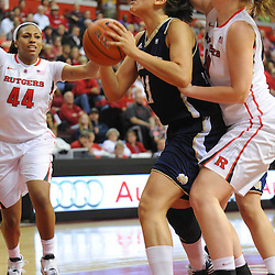 Notre Dame Fighting Irish forward Natalie Achonwa (11) is fouled by Rutgers Scarlet Knights forward/center Christa Evans (20) during first half NCAA Big East women's basketball action between Notre Dame and Rutgers at the Louis Brown Athletic Center. Notre Dame leads 40-23 at halftime.