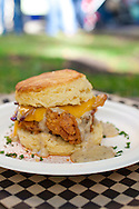 """Pine State Biscuits in Portland, OR at the Saturday Farmers' Market in the South Park Blocks in Portland State University's Campus.. The """"Reggie Deluxe"""" - a buttermilk biscuit with fried chicken, Tillamook cheddar cheese, bacon, a fried egg, all toopped with home made gravy."""