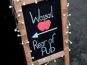 The Wassail sign at the Old Star public house in Kilham village, Yorkshire Wolds, UK on 21st January 2017. Wassail is a traditional Pagan winter celebration in cider-producing regions of England, reciting incantations and singing to the trees to promote a good harvest for the coming year. Pieces of toast soaked in cider are hung in the branches to attract robins to the tree as these are said to be the good spirits of the orchard. To ward off evil spirits, villagers scare them away by banging pots and pans and making as much noise as possible