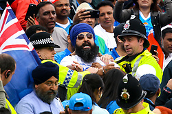 India fans wearing Punjab referendum shirts are arrested at Old Trafford during India v New Zealand in the Cricket World Cup - Mandatory by-line: Robbie Stephenson/JMP - 09/07/2019 - CRICKET - Old Trafford - Manchester, England - India v New Zealand - ICC Cricket World Cup 2019 - Semi Final