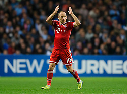 Bayern Forward Arjen Robben (NED) applauds the travelling supporters as he is substituted during the second half of the match - Photo mandatory by-line: Rogan Thomson/JMP - Tel: Mobile: 07966 386802 - 02/10/2013 - SPORT - FOOTBALL - Etihad Stadium, Manchester - Manchester City v Bayern Munich - UEFA Champions League Group D.