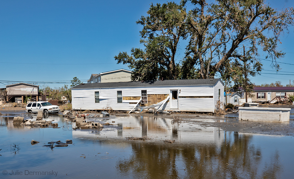 Damaged home surronded by flood water nearly two weeks after Hurricane Ida hit.