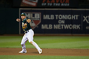 Oakland Athletics third baseman Matt Chapman (26) fires a throw to first base against the San Francisco Giants at Oakland Coliseum in Oakland, California, on August 1, 2017. (Stan Olszewski/Special to S.F. Examiner)