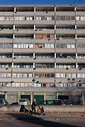 The mother pushes her childs buggy tall block of flats on the Thurlow Street estate, on 28th November 2016, in the south London borough of Southwark, England.