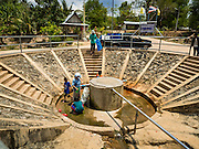 09 MAY 2016 - TA TUM, SURIN, THAILAND:    People get water from the artesian well in Ta Tum, Surin, Thailand. The well is the most important source of drinking water for thousands of people in the communities surrounding it. In the past many of the people had domestic water piped to their homes or from wells in their villages but those water sources have dried up because of the drought in Thailand. Thailand is in the midst of its worst drought in more than 50 years. The government has asked farmers to delay planting their rice until the rains start, which is expected to be in June. The drought is expected to cut Thai rice production and limit exports of Thai rice. The drought, caused by a very strong El Nino weather pattern is cutting production in the world's top three rice exporting countries:  India, Thailand and Vietnam. Rice prices in markets in Thailand and neighboring Cambodia are starting to creep up.     PHOTO BY JACK KURTZ