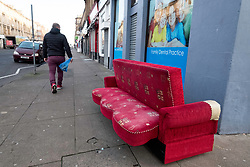 Bench seat left on street in Govanhill district of Glasgow, Scotland, United Kingdom