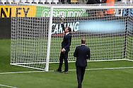 Referee Neil Swarbrick tests the goal line hawk eye system. Premier league match, Swansea city v Manchester city at the Liberty Stadium in Swansea, South Wales on Saturday 24th September 2016.<br /> pic by Andrew Orchard, Andrew Orchard sports photography.