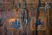 HUSTLE, VIRGINIA - JULY 26: Horse tack and artwork adorn the wall in Randy Silvers' and Carolyn Berry's antique carriage barn on their Rock Spring Farm on Sunday, July 26, 2015 in Hustle, Virginia. The couple are giving away their 18th-century horse farm, that Silvers and his first wife rebuilt and restored, by hand-picking the next owner to the winner of an essay contest. (Photo by Pete Marovich For The Washington Post)