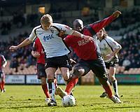 Photo: Glyn Thomas.<br />Port Vale v Swansea City. Coca Cola League 1. 08/04/2006.<br />Swansea's Adebayo Akinfenwa (R) battles for the ball with Craig James.