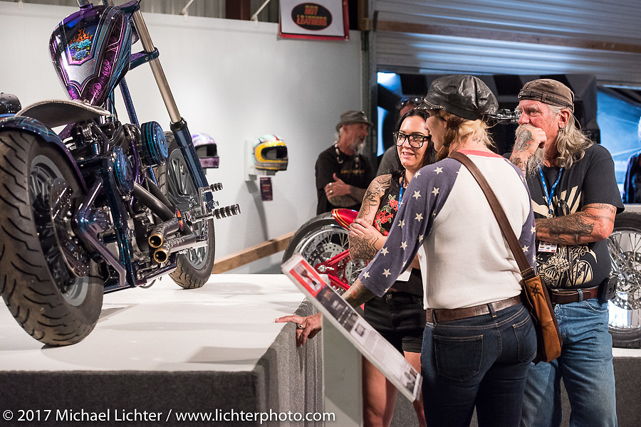 Nikki Martin talks with Mailman and Debi Holmes at the Old Iron - Young Blood exhibition media and industry reception in the Motorcycles as Art gallery at the Buffalo Chip during the annual Sturgis Black Hills Motorcycle Rally. Sturgis, SD. USA. Sunday August 6, 2017. Photography ©2017 Michael Lichter.