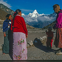Meredith Wiltsie & 3-year old son Ben chat with Sherpani women in Khumjung village while trekking  in the Khumbu Region of Nepal.  Mount  Ama Dablam  in background.