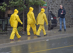Three men sport weather gear in Halifax as hurricane Dorian approaches on Saturday, September 7, 2019, Canada. Photo by Andrew Vaughan/CP/ABACAPRESS.COM