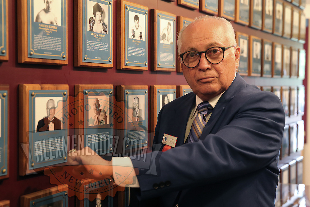 CANASTOTA, NY - JUNE 14: Boxing promoter Rafael Mendoza poses with his new ring and photo on the wall after the induction ceremony at the International Boxing Hall of Fame induction Weekend of Champions events on June 14, 2015 in Canastota, New York. (Photo by Alex Menendez/Getty Images) *** Local Caption *** Rafael Mendoza