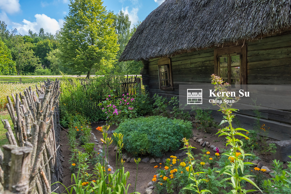Wooden house with garden in the open-air ethnographic museum in Rumsiskes, Lithuania
