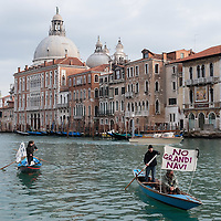 "VENICE, ITALY - JANUARY 16:  Protesters sailing on the Grand Canal hold  banners reading ""Stop the large Ships""  on the day of the special meeting discussing the environmental impact of cruises in Venice on January 16, 2012 in Venice, Italy. Protest are mounting in Venice against large cruise ships crossing St Marks's basin after the Costa Concordia tragedy."