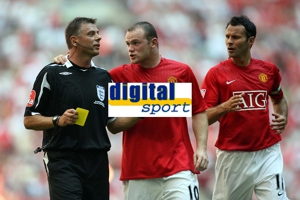 Photo: Rich Eaton.<br /> <br /> Manchester United v Chelsea. FA Community Shield. 05/08/2007. Man United's skipper Ryan Giggs (r) looks on as Wayne Rooneys (c) discusses his yellow card with referee Mark Halsey