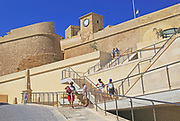 Tourists outside the citadel castle walls Il-Kastell, Victoria Rabat, Gozo, Malta