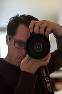 I took a self-portrait with my Canon EOS 5D Mark II at a DoubleTree Hilton Hotel for a photography series.