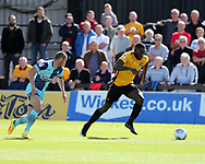 Frank Nouble of Newport County ® makes a break. EFL Skybet football league two match, Newport county v Wycombe Wanderers at Rodney Parade in Newport, South Wales on Saturday 9th September 2017.<br /> pic by Andrew Orchard, Andrew Orchard sports photography.