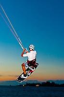 Kite surfing at sunset, Plage du Meridien (Anse Vata), Noumea, Grand Terre, New Caledonia