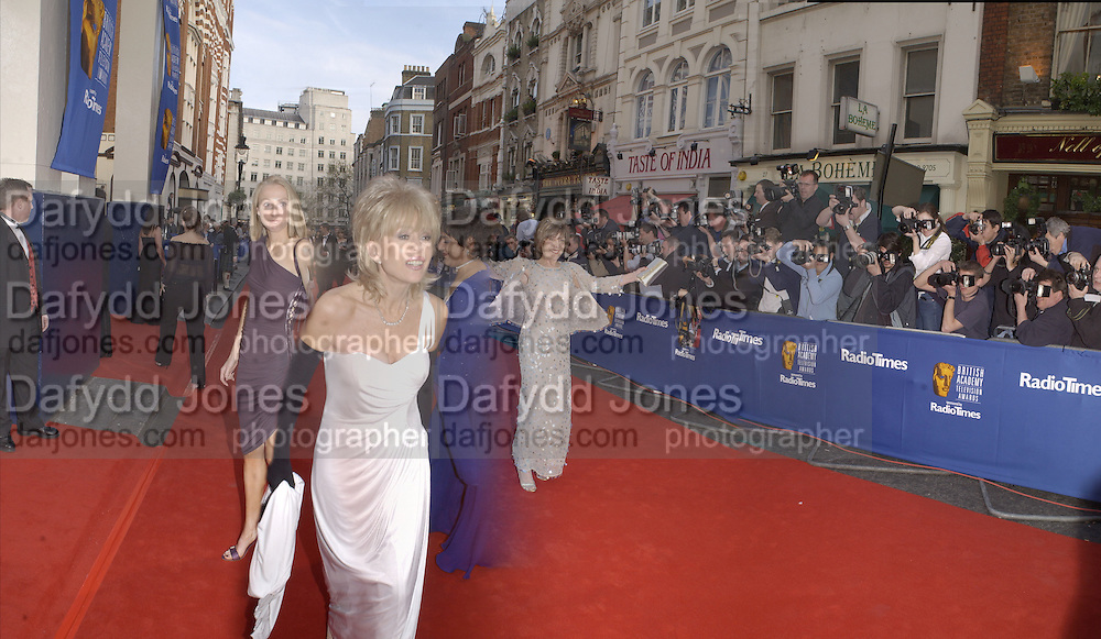 Meera Syal, Sally Farmilloe and Joan Collins. TV Bafta Awards. 21 April 2002. © Copyright Photograph by Dafydd Jones 66 Stockwell Park Rd. London SW9 0DA Tel 020 7733 0108 www.dafjones.com