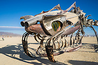 Serpent Mother from: San Francisco, CA year: 2015<br /> <br /> The Serpent Mother is a 168′ long sculpture of a skeletal serpent, coiled around her egg. Propane fire runs down her spine, with 41 poofers erupting from the top of her gleaming vertebrae. Reaching 20' in the air, her hydraulically-actuated head and jaws chomp at the sky.<br /> <br /> The serpent is a highly kinetic, participant-controlled installation. Fire effects are a major interactive and sculptural element of the piece, controlled by pushing buttons located on the ribs. The audience is invited to direct her movements, using controls that move the head and jaws, effectively making each show a unique event created by the participants.<br /> <br /> Twice every evening, the operator crew will perform methanol shows, shooting multi-colored flames 40′ in the air from the egg, illuminating the night sky. URL: http://flaminglotus.com/art/the-serpent-mother/ Contact: info@flaminglotus.com