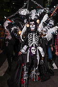 New York, NY - 31 October 2019. the annual Greenwich Village Halloween Parade along Manhattan's 6th Avenue. A man costumed as a skeleton, with elaborately feathered pieces.