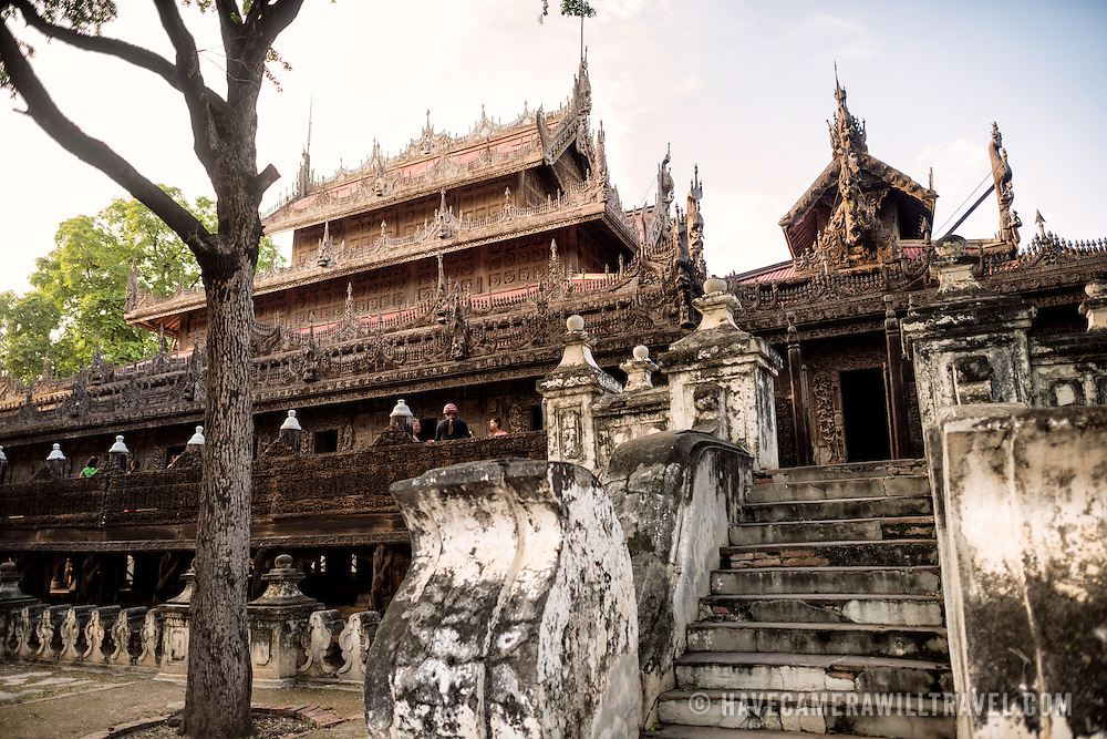 Built in 1880 of carved teak, Shwenandaw Monastery was originally part of the Royal Palace at Amarapura. It was later moved to a site near Mandalay Hill in Mandalay. It is built in the traditional Burmese architectural style and is notable for its ornate carvings of Buddhist mythology and its interior featured extensive guilt work and glass mosaics.