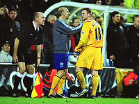 Wayne Rooney (Everton) is held back from clashing with the linesman by physio / trainer, Mick Rathbone. Fulham v Everton. FA Cup 4th rd Replay. 04/02/2004. Credit : Colorsport/Andrew Cowie.